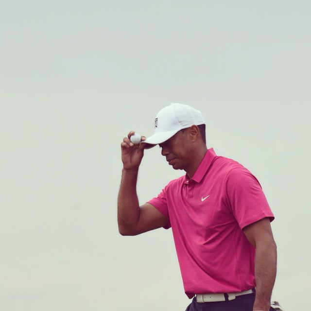 Tiger Woods acknowledges the crowd during round one of the WM Phoenix Open
