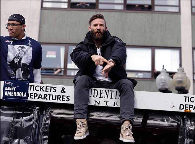 Julian Edelman celebrates on top of his duck boat