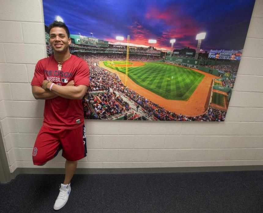 Yoan Moncada was all smiles Wednesday at Red Sox camp. He will look to follow in the footsteps of fellow Cuban stars Yasiel Puig and Jose Abreu